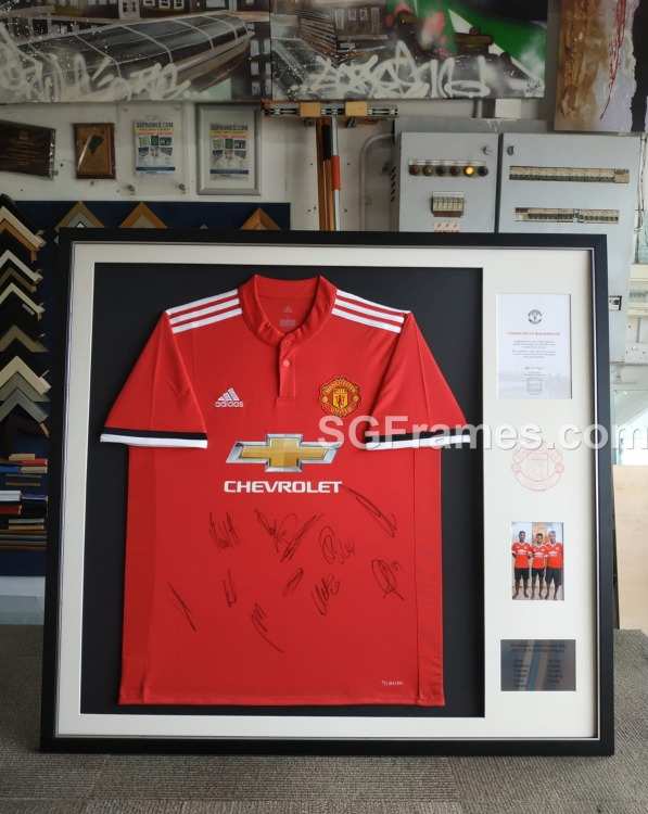 SGFrames.com_Jersey_Framing_with_Certificate_of_Authenticity,_Logo_drawing,_Photo_and_Metal_plate.png
