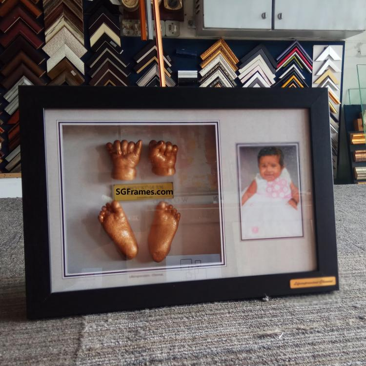 SGFrames.com Baby Toa and Hands sculpture  framing 002.jpg