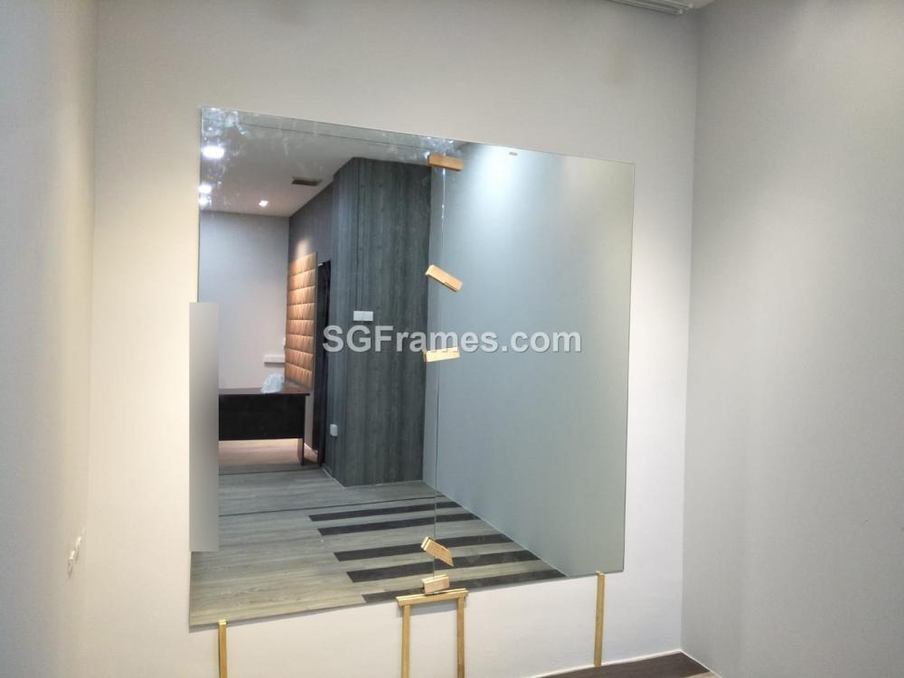 SGFrames.com Frameless Mirror Installation with two Joints.jpeg