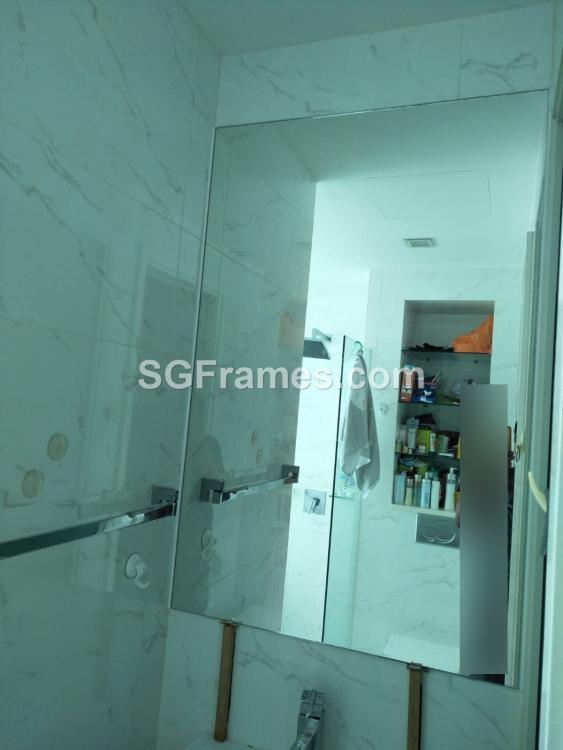 SGFrames.com Frameless Mirror Installation on Toilet.jpeg