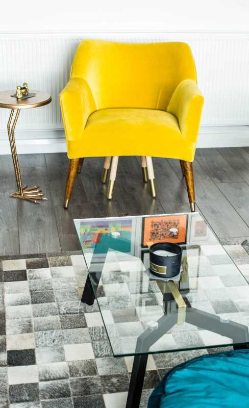 makeover will help you incorporate old furniture into a new home - a yellow chair with a glass table