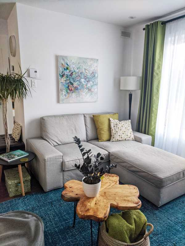 A grey sofa and a coffee table in a room with white walls